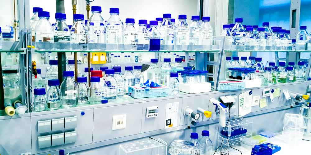 life sciences research laboratory with many blue glass bottles