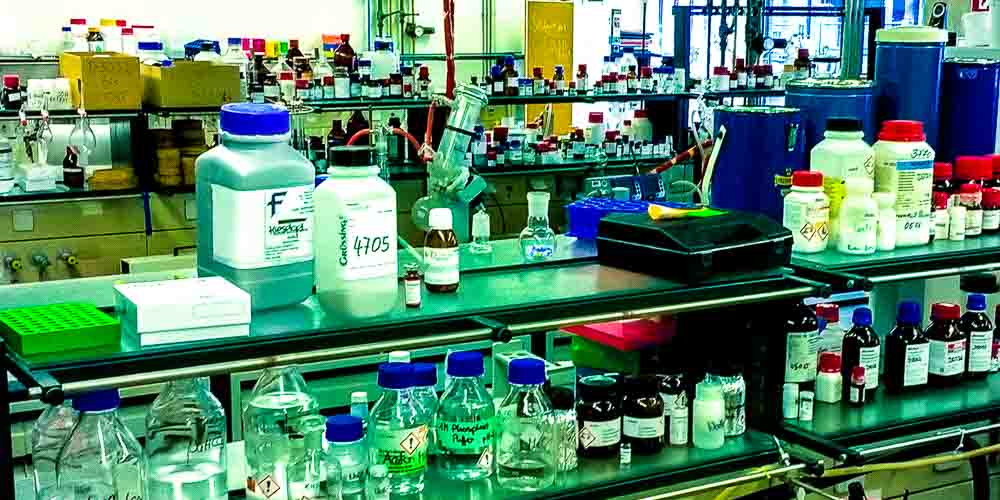 life sciences research laboratory with many glass bottles